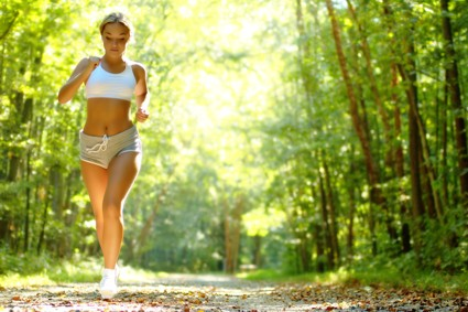 Women jogging in forest for fitness